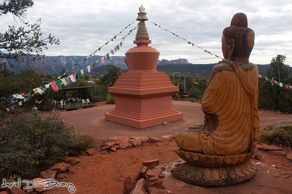 Buddha statue behind the stupa